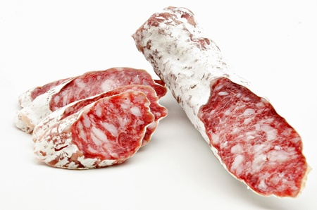 longaniza: Several pieces of Salchichon next to each other surrounded by white background