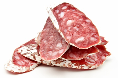 Several slices of Salchichon next to each other surrounded by white background photo