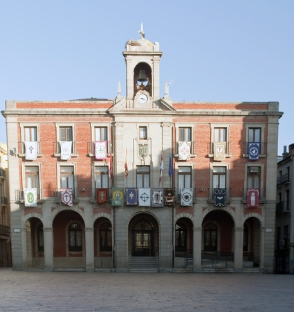 zamora: Zamora facade of City Hall with flags in the windows and a bell on top Editorial