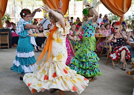 Women in traditional flamenco dancing during the show the horse the day May 12, 2012, in Jerez de la Frontera, Spain