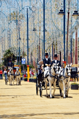 People in carriage horses walking in the royal house of the fair on the horse fair the day May 12, 2012 in Jerez de la Frontera, Spain