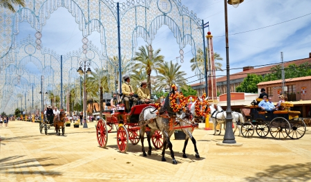 People in carriage horses walking in the royal house of the fair on the horse fair the day May 12, 2012 in Jerez de la Frontera, Spain  Stock Photo - 13601892