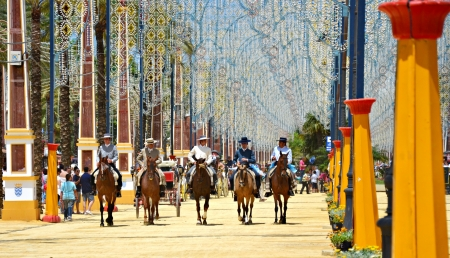 show horse: Riders on horseback walking through the real show horse at the fair the day May 12, 2012 in Jerez de la Frontera, Spain