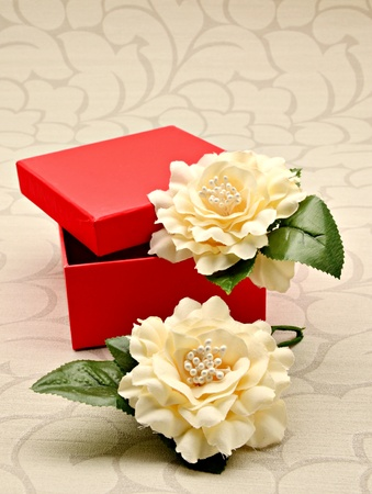 Open red box with white flower photo