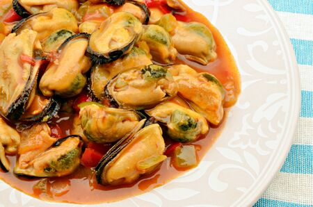 Mussel stew with tomato sauce, onion and pepper photo