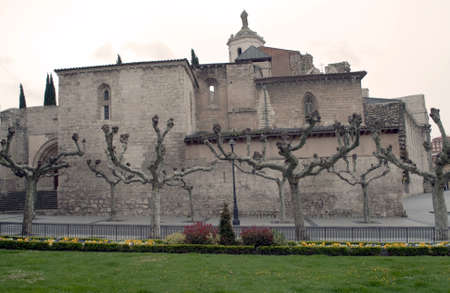 Romanesque church , located in the Spanish city of Valladolid, is surrounded by dead trees an a garden with flowers Stock Photo - 13681892