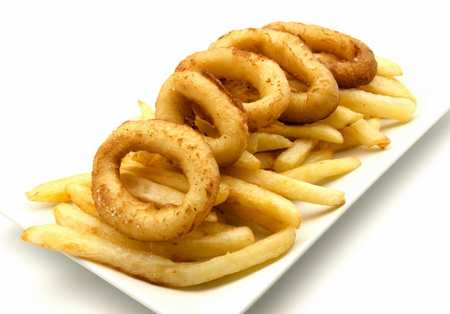 Plate of squid and chips surrounded by white background photo