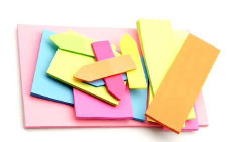 Colored paper for notes, surrounded by white background photo