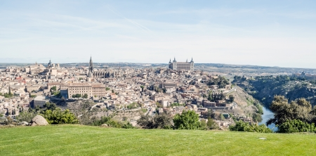 Distant view of the the Spanish city of Toledo, in one side the river tagus, in the other side the medieval city of Toledo environment  You can see the village surrounded by the Tagus river Stock Photo - 13801369