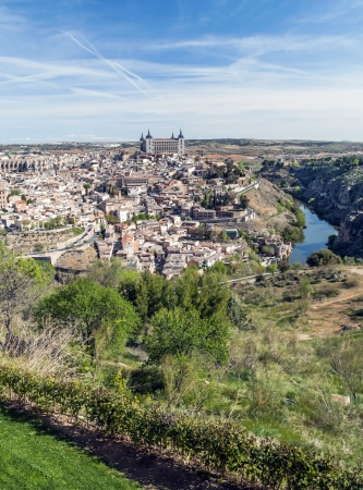 View of the Spanish city of Toledo, seen from the alcazar, in a structure of medieval city  In one side the tagus river Stock Photo - 13801389