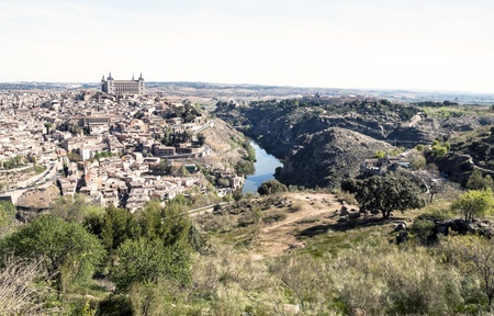 View of the Spanish city of Toledo, seen from the alcazar, in a structure of medieval city  In one side the tagus river Stock Photo - 13801390