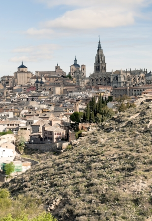 Cathedral and monastery of Santa Maria of the Spanish city of Toledo surrounded by the houses of the village, is a medieval city in the foreground are the mountains Stock Photo - 13801387