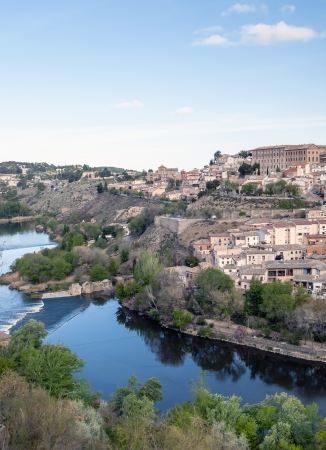 Distant view of the the Spanish city of Toledo, in one side the river tagus, in the background the l city of Toledo with its houses Stock Photo - 13801377