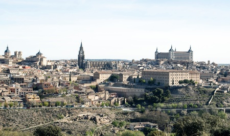 View of the Spanish city of Toledo, seen from the Gothic cathedral of Santa Maria and the alcazar, in a structure of medieval city photo