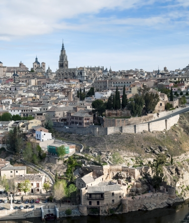 View of the Spanish city of Toledo in vertical, seen from the river to the Gothic cathedral of Santa Maria, surronded by houses Stock Photo - 13801372