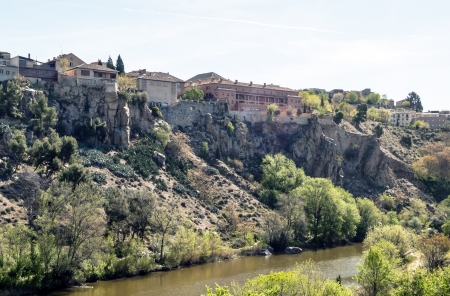 Houses at the top of the slope of the river bank cut in the Spanish city of Toledo photo
