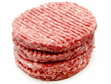 Several burgers on top of each other surrounded by white background photo