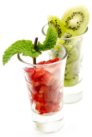 Two glasses with slices of strawberry and kiwi, surrounded by white background Stock Photo - 13949080