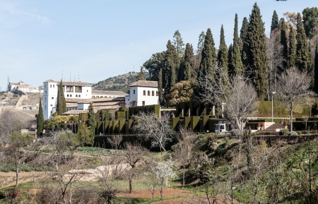 White house surrounded by trees in Granada photo