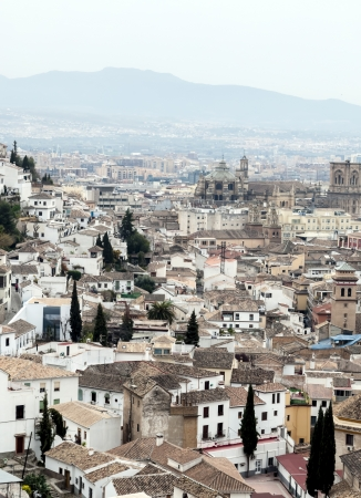 Aerial view of the Spanish city of Granada with its Gothic cathedral with white houses  photo
