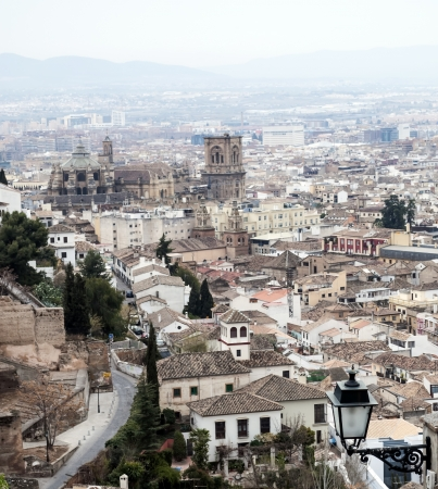 Aerial view of the Spanish city of Granada with its Gothic cathedral with white houses and a road, it s a vertical image photo
