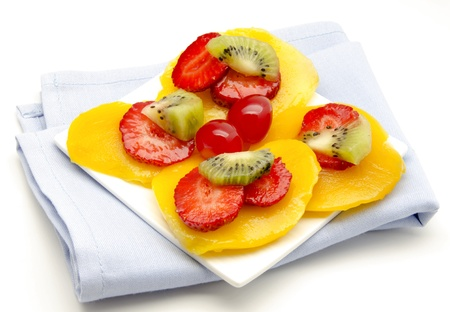 Mango, strawberry and kiwi on a napkin, surrounded by white background Stock Photo - 14036514