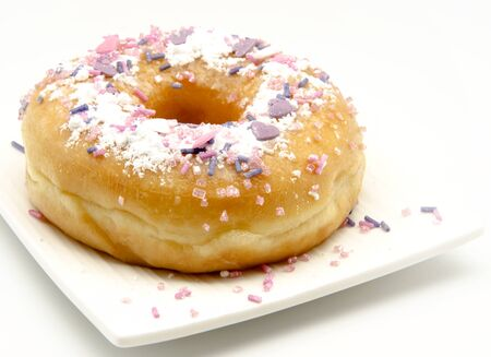 Donut decorated served on a plate surrounded by white background Stock Photo - 14036511