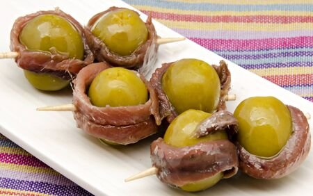 Olives with anchovy appetizer photo