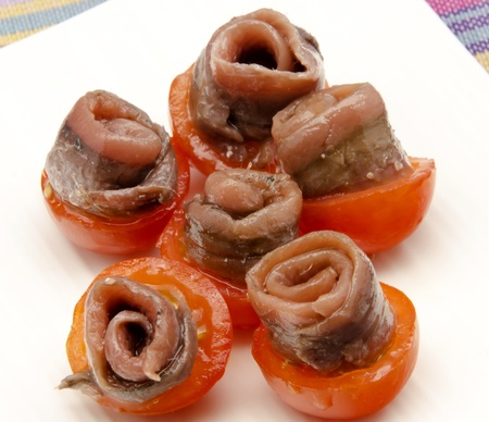 Appetizer anchovy with cherry tomato photo