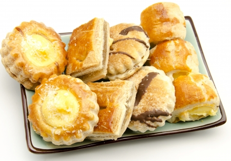 Assorted cakes and pastry cream photo