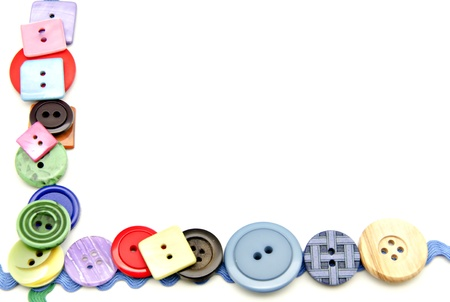 seam: Plastic buttons in different colors on white fund