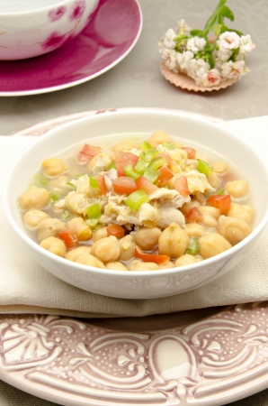 Chickpea stew with meat, pepper and tomato photo