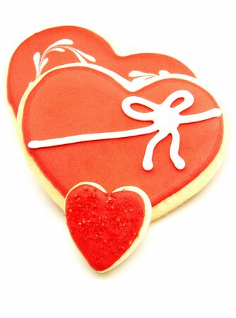 Cookies decorated with heart shape on white background photo