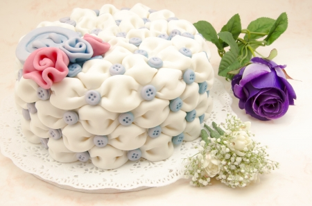White wedding cake with blue flowers on white background photo