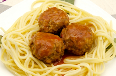 Spaghetti with meatballs stew meat and tomato sauce photo