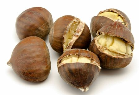 Several chestnuts surrounded by white background photo