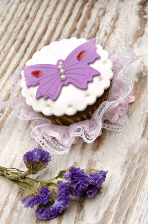 Cupcakes decorated with colored sugar flowers Stock Photo - 16440555
