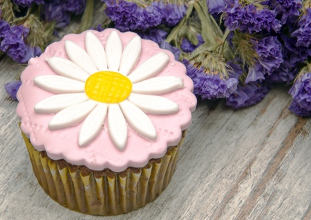 Cupcakes decorated with colored sugar flowers Stock Photo - 16440545