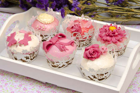 Cupcakes decorated with fondant and sugar flowers Stock Photo - 16513426