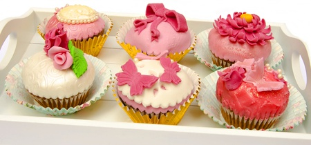 Cupcakes decorated with fondant and sugar flowers Stock Photo - 16513433