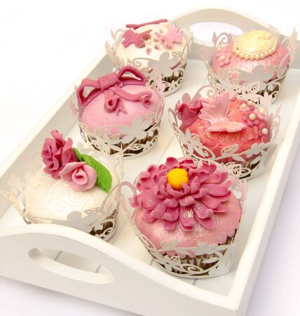 Cupcakes decorated with fondant and sugar flowers Stock Photo - 16513421