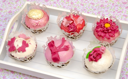 Cupcakes decorated with fondant and sugar flowers Stock Photo - 16513428