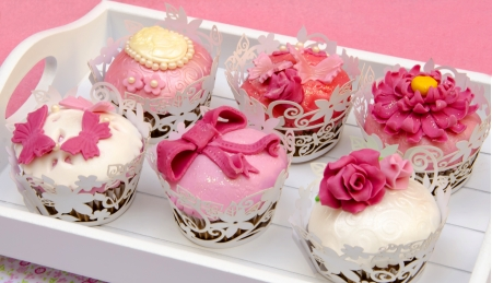 Cupcakes decorated with fondant and sugar flowers Stock Photo - 16513417
