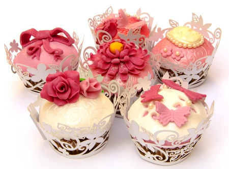 wedding cake: Cupcakes decorated with fondant and sugar flowers Stock Photo