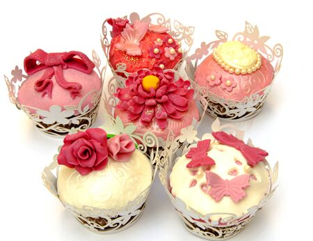 Cupcakes decorated with fondant and sugar flowers Stock Photo - 16513422