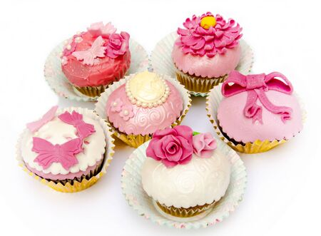 Cupcakes decorated with fondant and sugar flowers photo