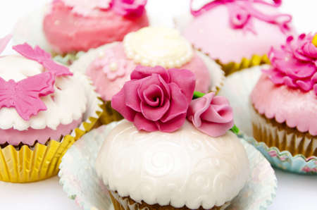 Cupcakes decorated with fondant and sugar flowers Stock Photo - 16513429