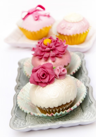Cupcakes decorated with fondant and sugar flowers Stock Photo - 16513418