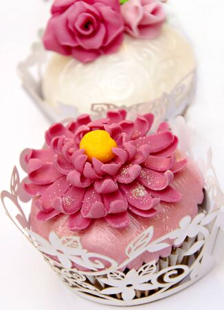 Cupcakes decorated with fondant and sugar flowers Stock Photo - 16513427