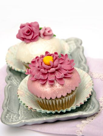 Cupcakes decorated with fondant and sugar flowers Stock Photo - 16513425